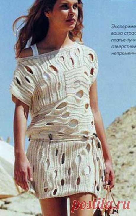 Платье-туника с интересным узором Платье-туника с интересным узором выполнено спицами с интересным «сквозным» узором. Схема вязания