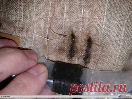 Раздвинули ткань электрогрелки (ткань потемнела)