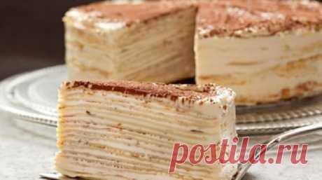 Торт «Kрепвиль»  Ингредиенты Тесто для коржей:  80 г сливочного масла комнатной температуры 100 г сахара 2 яйца 300 мл молока 1/2 ч.ложки разрыхлителя 800-900 г муки  Заварной крем со сгущенным молоком:  650 мл молок…