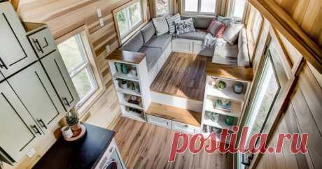 Clover tiny house comes with its own large 'social area' (Video) No half-done couch here; there's a big place to sit and socialize.