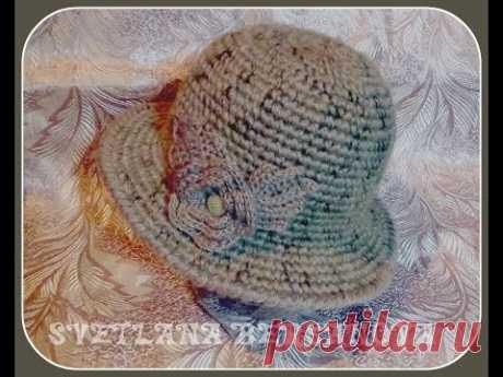 El sombrero de señora caliente por el gancho. La parte 2.Crochet hat w
