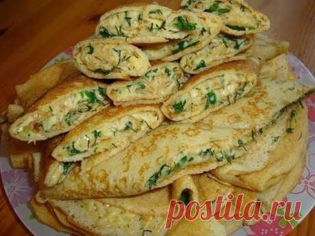 Pancake envelopes with cheese and greens — it is very tasty!
