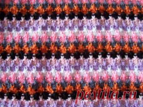 Красивые многоцветные узоры спицами  Как использовать остатки пряжи... Узор Феерверк  Число петель кратно 4, плюс 3 петли для симметрии, плюс 2 кромочные.Описание узора: 1 и 3 ряды, нить №1 — * 3 лицевых, 1 п. снять (нить за петлей), * …