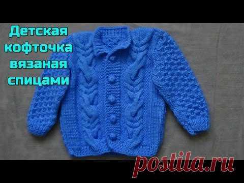 Knitting of a children's jacket spokes. Baby knitting