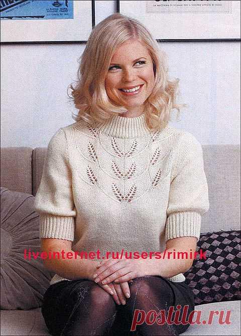 Белый пуловер с ажурным узором от финского дизайнера Lea Petaja (спицы).