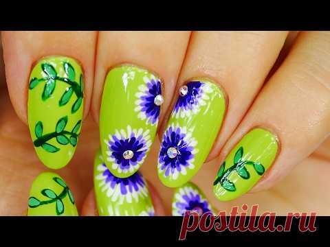 Nail Art. Green Design with Purple Flowers.