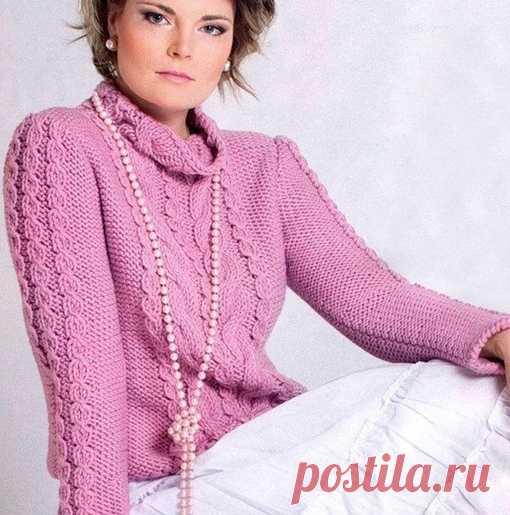 Розовый, теплый свитер с косами не оставит ни одну модницу равнодушной.