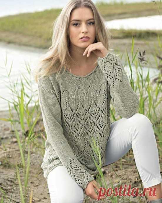 Салатовый пуловер с ажурным узором.