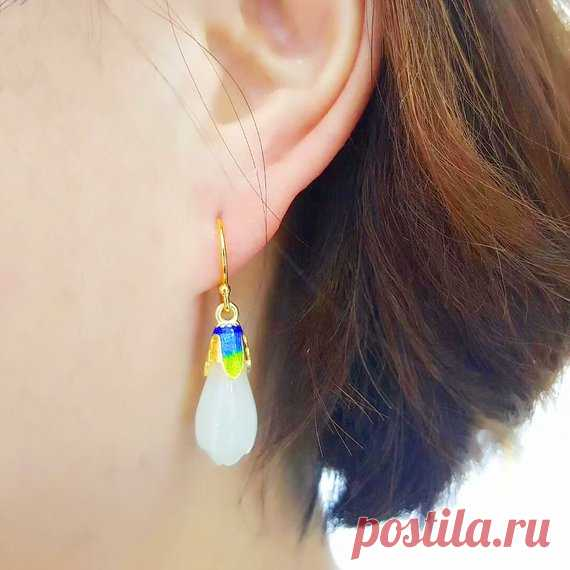White hetian jade Orchid Dangle & Drop Earrings /925 silver magnolia earrings / cloisonne inlaid earrings / aunt gift Product Details:  Material: Hetian jade, 925 silver  color: White  Shape: flower  Size: height 34, width 8.5 (mm)  Weight: 9.4g (27 carats)  Translucent: translucent