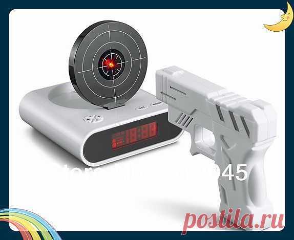 Будильник для настоящих мужиков! Достал будильник - убей его! Сам купил такой, теперь сплю с пистолетом под подушкой. Прикольная штука.