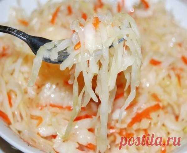 Very fast kapustka - 15 minutes are also ready!\u000d\u000aPreparation:\u000d\u000aWe take at the rate of three kilograms of cabbage.\u000d\u000aTo chop cabbage. \u000d\u000aTo grate three large carrots on a large grater. To squeeze out 3-4 garlic gloves from the spadefoot. \u000d\u000aTo mix everything. \u000d\u000aWe do marinade:\u000d\u000aWe put one and a half liters of water on fire. We add 200 gr.sakhar, 3 tablespoons of salt (without top),\u000d\u000a250 gr. sunflower oil. When begins to boil to pour 200 gr. vinegar of 9%. 2-3 minutes have to boil. \u000d\u000aMarinade is ready.\u000d\u000aWe fill in cabbage it is hot...