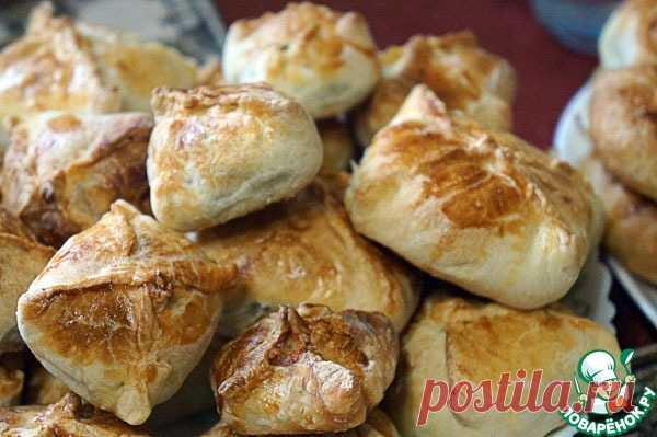 Пирожки из слоеного теста с рыбой – кулинарный рецепт