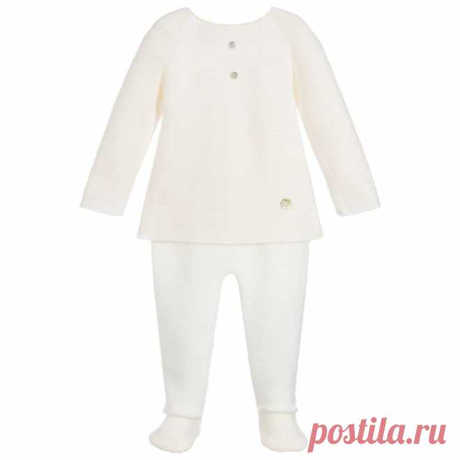 Ivory Knitted 2 Piece Babygrow Lovely ivory two-piece babygrow for boys and girls byPaz Rodriguez. Knitted in super soft blend of cotton Merino wool, with delicate patterned trims. It has decorative mother-of pearl buttons on the front.