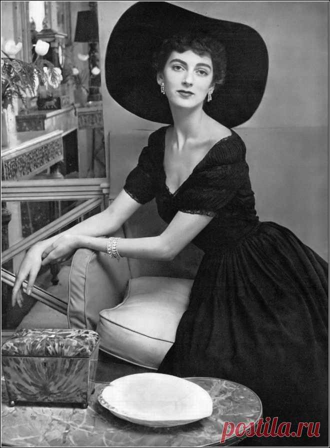 Carmen Dell' Orefice in late-day black dress of silk crêpe… | Flickr