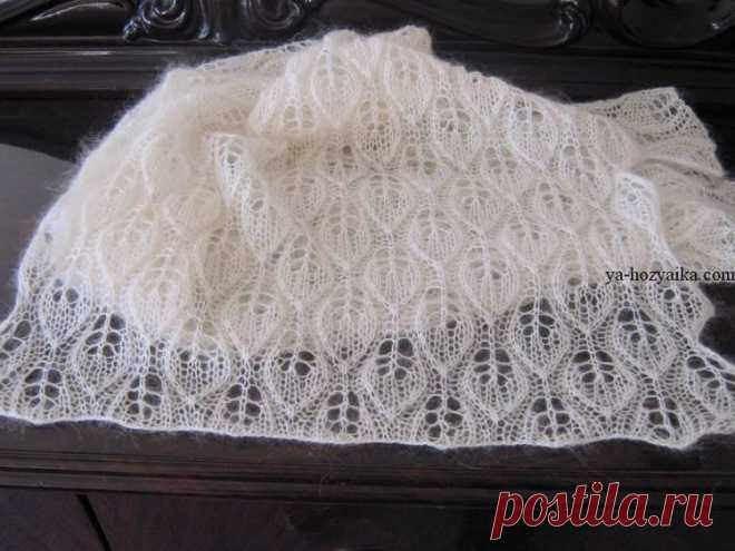 Openwork shawl from a mohair spokes. A shawl from a scheme mohair the Openwork shawl from a mohair spokes. A shawl from a scheme mohair
