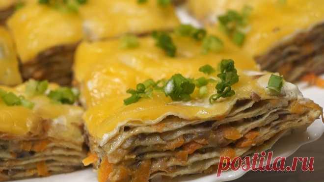 Безумно вкусная закуска из лаваша, все будут сыты и довольны Рецепт совершенно простой и быстрый в приготовлении, гости непременно оценят такую интересную закуску с грибами и сыром. Ингредиенты Лаваш тонкий – 2 шт. Грибы – 500гр Морковь – 1 шт. Сметана –2 ст.л