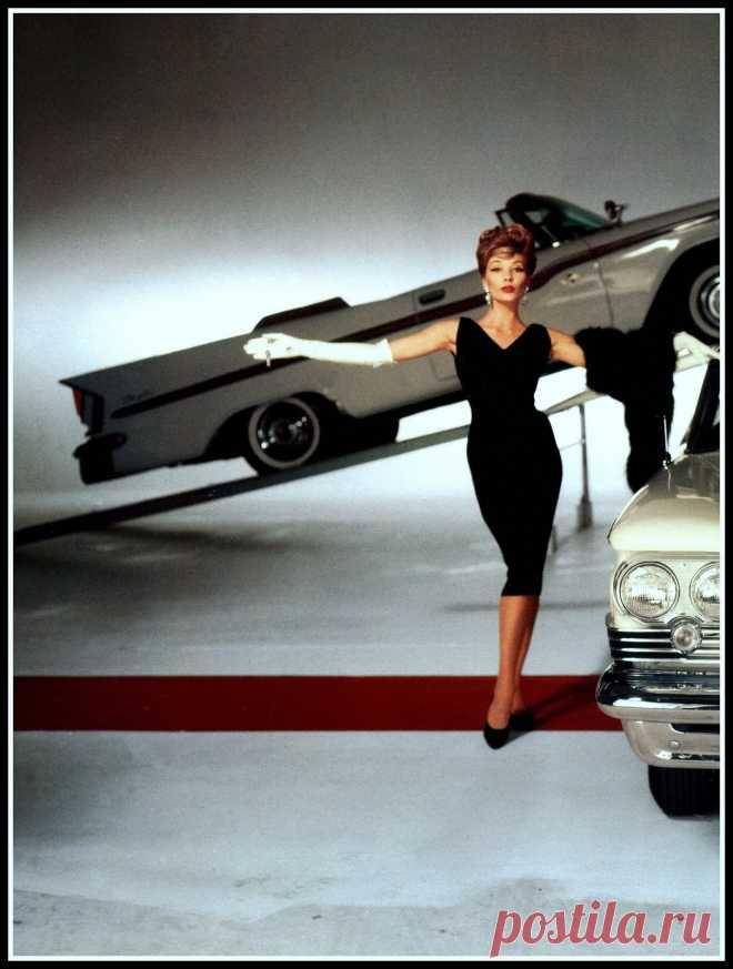Jessica Ford in a slim black sheath worn with fur stole, 1957